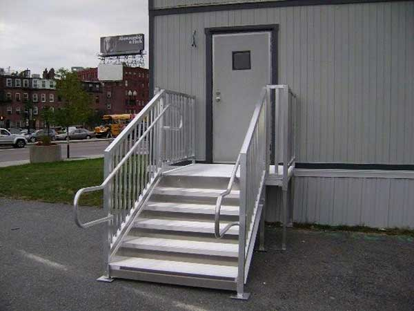 Metal steps attach to decks, trailers and platforms.